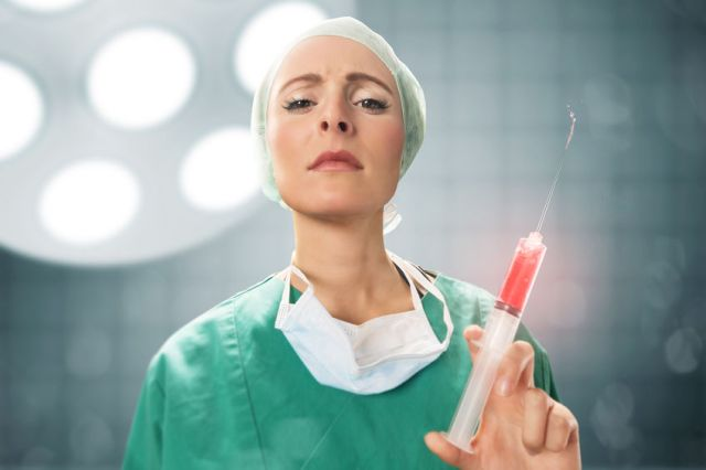 Female Doctor with big injection
